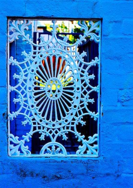art design, design element tone, negative spaces, blue patio wall white lattice patterns, debiriley.com
