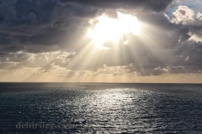 seaside sunburst, hope comes, sun comes out, sea and sun photo, debiriley.com